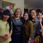 Jan Hoyle with students she's hosted through the International Friendship Program.