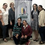 Assistant Professor Andrea Mulholland, DNP, FNP-C, and Assistant Professor Yamnia Cortés, PhD, MPH, FNP at continuing education conference in Manta, Ecuador.