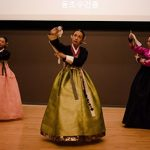 Three woman perform in traditional Korean clothing