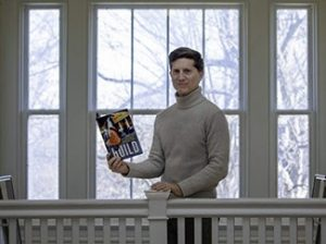 Mark Katz posing in front of a window with his book