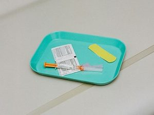 Medical tray with band aid, wipes and needle