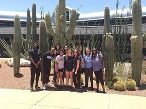 Group of students standing in front of cacti