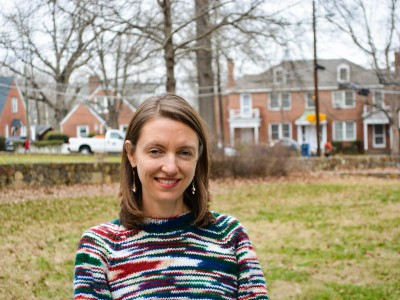 Head shot of Hannah Gill outside in front of houses