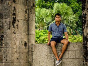 Karlo Montegrico, male student, sitting on ledge