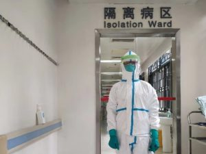 Linghua Li fully suited in protective gear in hospital ward.