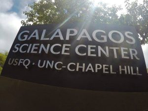 Sign that reads: Galapagos Science Center: USFQ - UNC-Chapel Hill