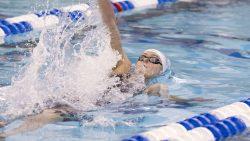 Countie swimming backstroke.