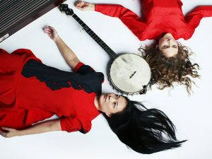 Album Cover of two women laying down with a banjo next to them