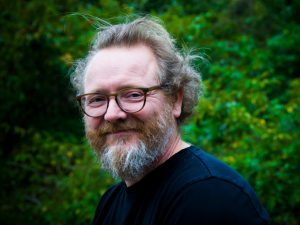 Headshot of Graeme Robertson outdoors.