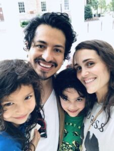 Selfies of Ramírez with his wife, Kyra, and two children — Milo and Camila — in front of the Old Well on UNC's campus.