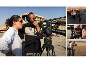 Screenshot of the presentation. The slide shows four photos of reporters on the scene with camera equipmentin the middle east.