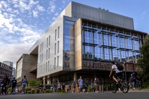 Genome Sciences Building with students walking by