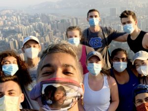 Students wearing face masks take a selfie